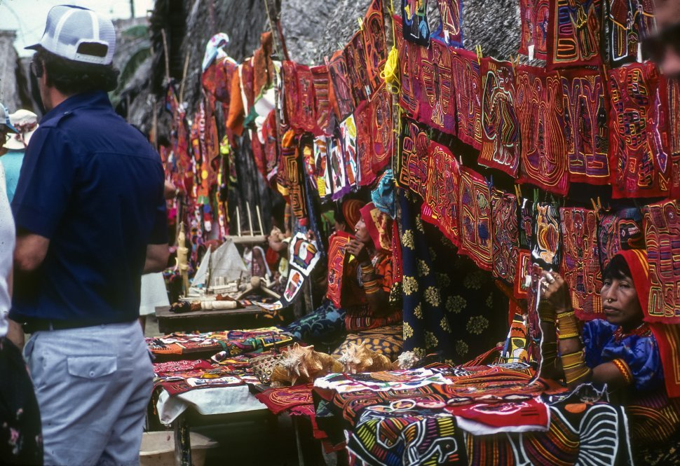 Free image of Ecuadorian women selling traditional textiles to tourists, Ecuador