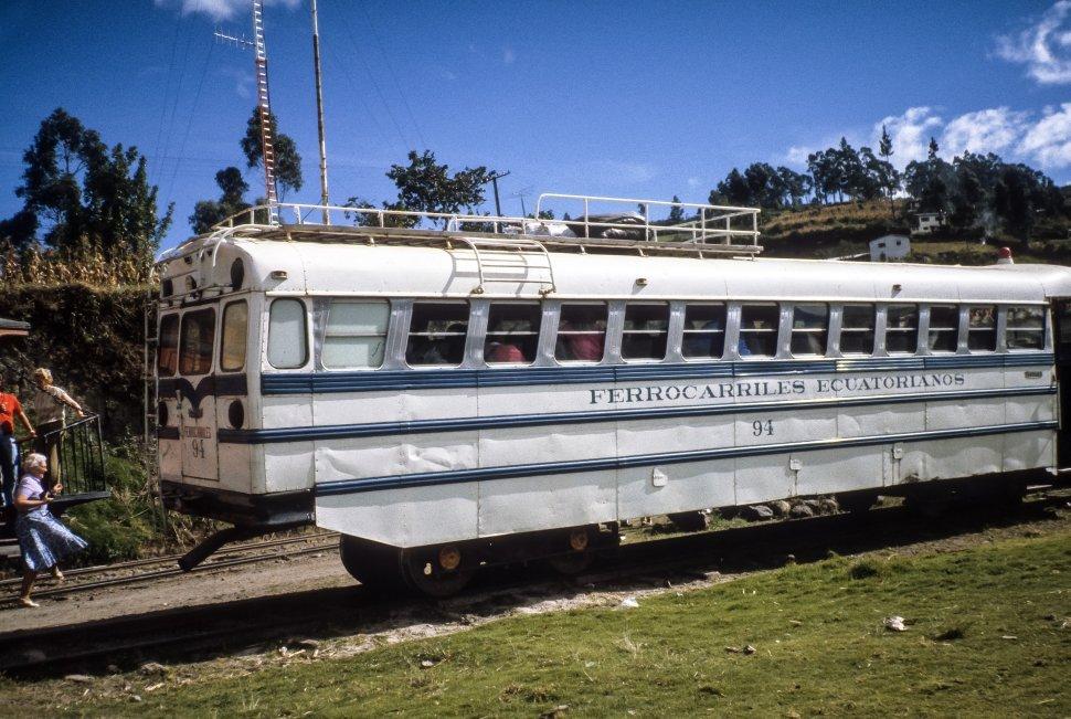 Free image of Ecuadorian tour bus driving on train tracks, Ecuador
