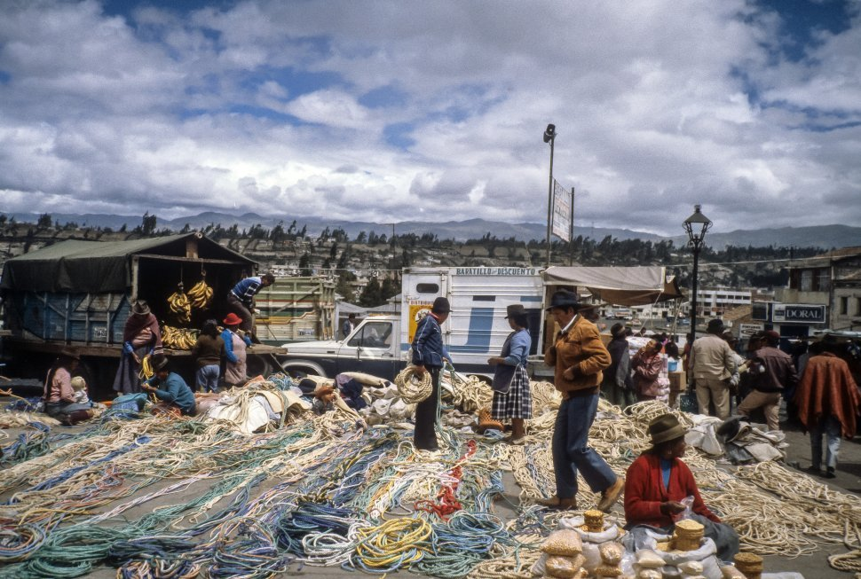 Free image of Woman selling colorful ropes in a busy marketplace, Ecuador