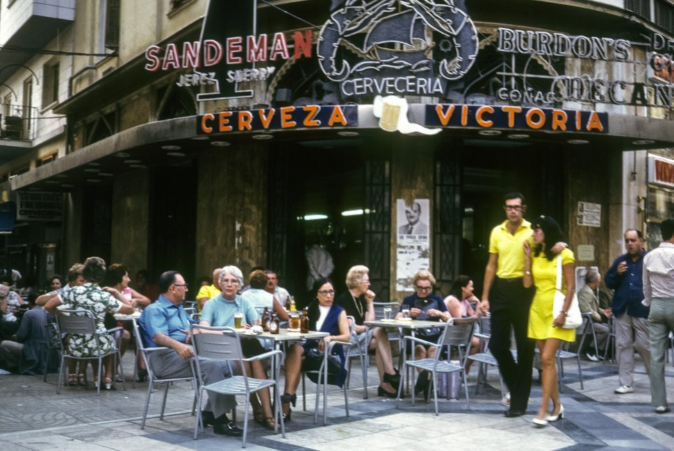Free image of Large group of people enjoying a sidewalk cafe, Europe