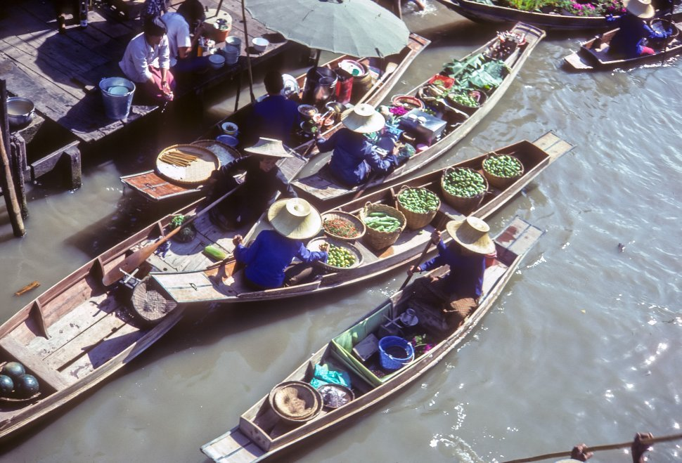 Free image of Vendors on a the water in a floating market, China
