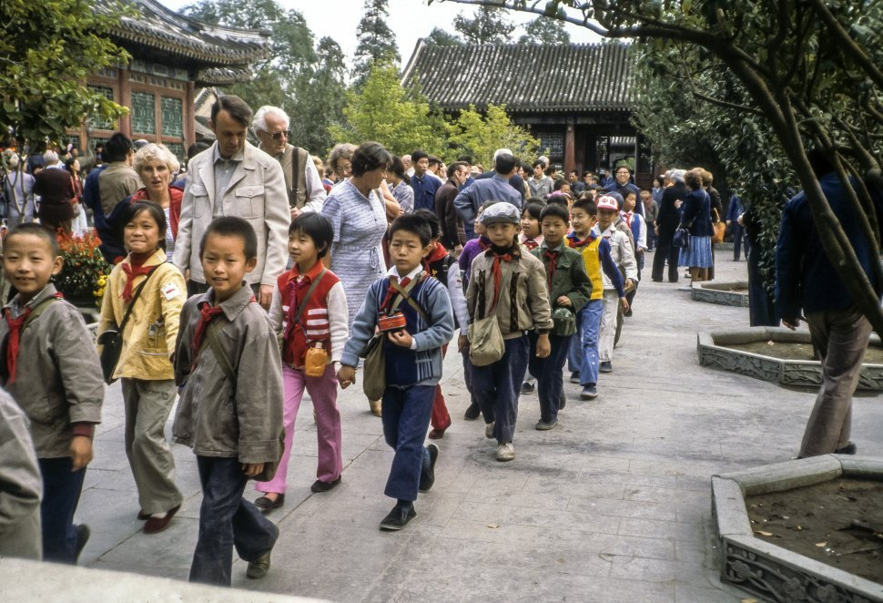 Free image of Tourists walking within a large group of school children, China