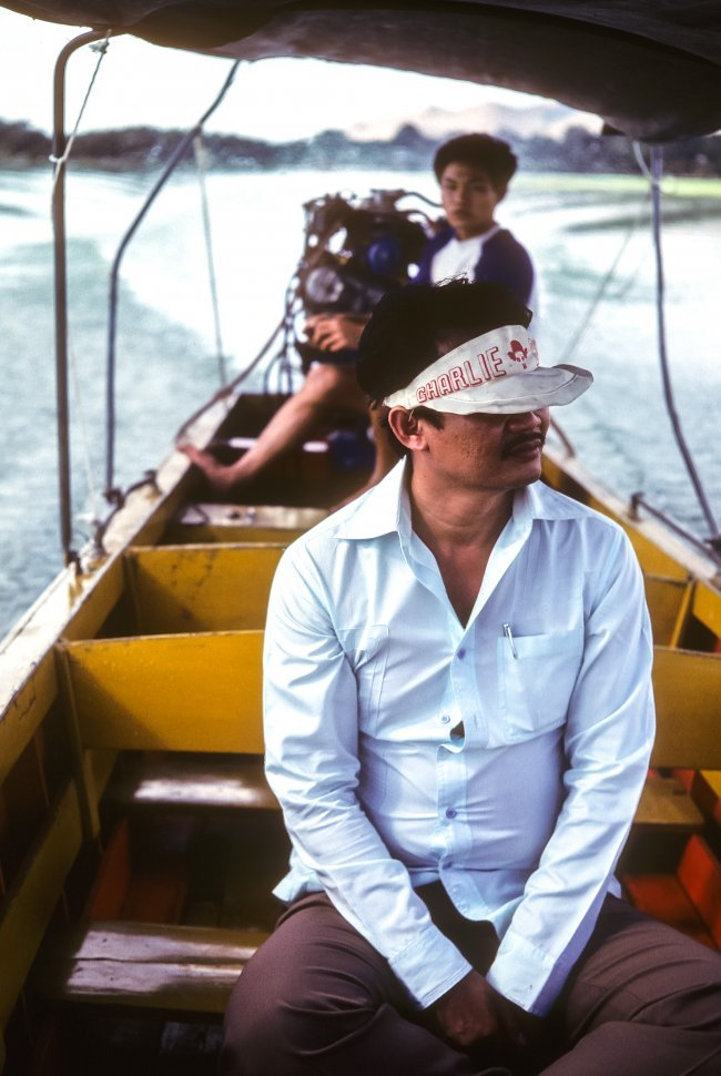 Free image of Two men sitting in a narrow boat, China
