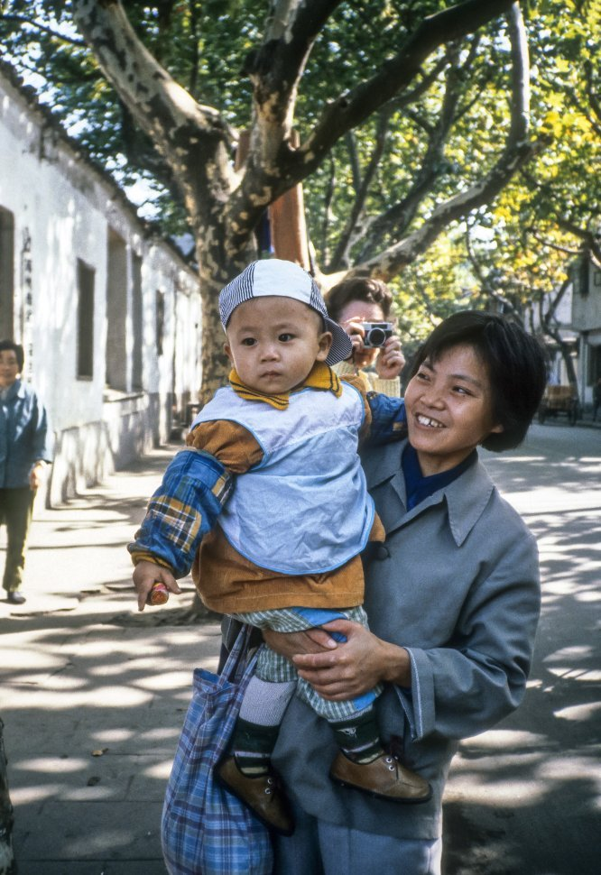 Free image of Woman posing with her son, China
