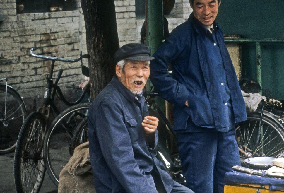 Free image of Old man smiling at the camera, China