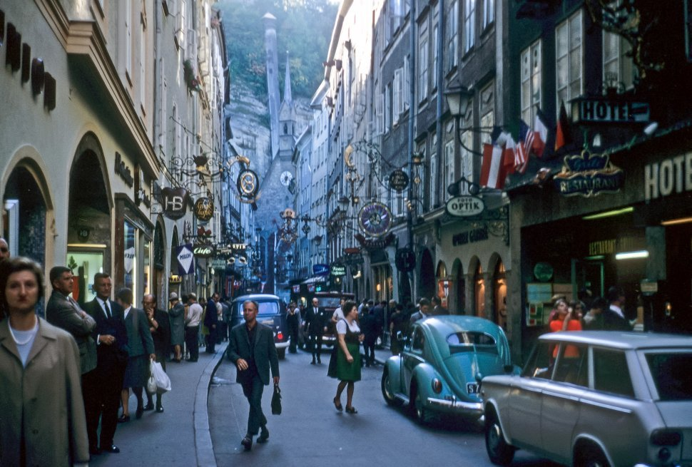 Free image of Cowded European street filled with shops and tourists, Europe