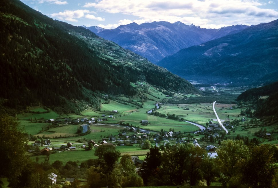 Free image of Aeril view of a mountain village in a valley, Europe