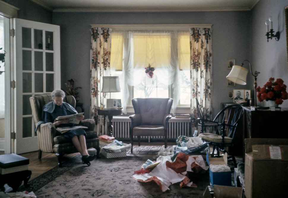 Free image of Woman relaxing with a paper after Christmas morning, USA