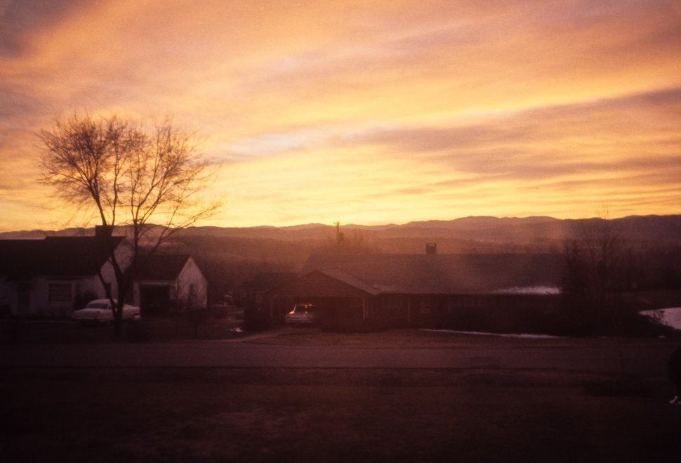 Free image of Sunset behind a rural home and cars, USA