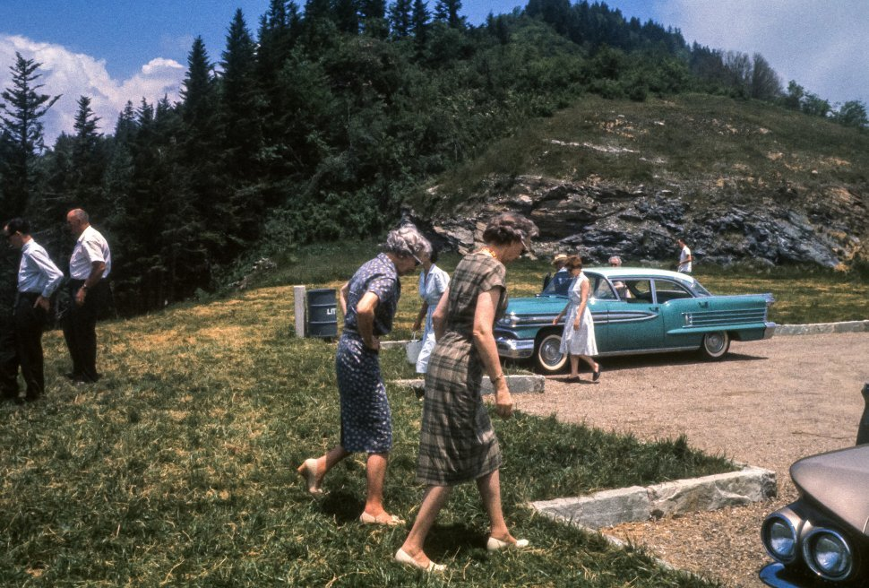 Free image of Tourists walking to and from their cars at a mountain rest stop, USA
