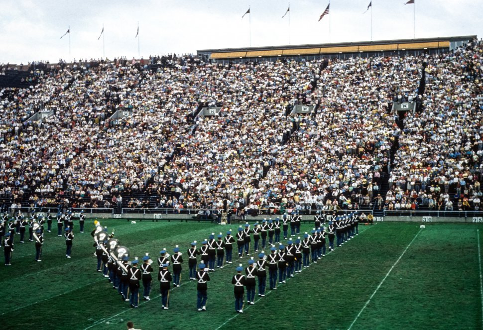 Free image of View of a crowded stadium with marching band performing, USA