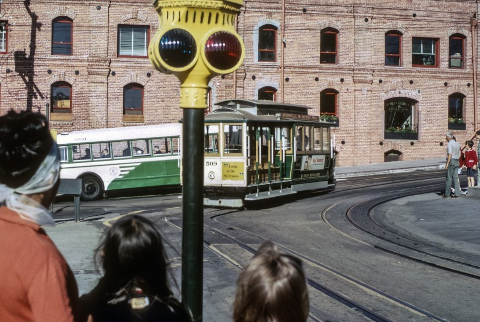 Free image of People waiting to cross the street while a cable car passes by, San Francisco, California, USA