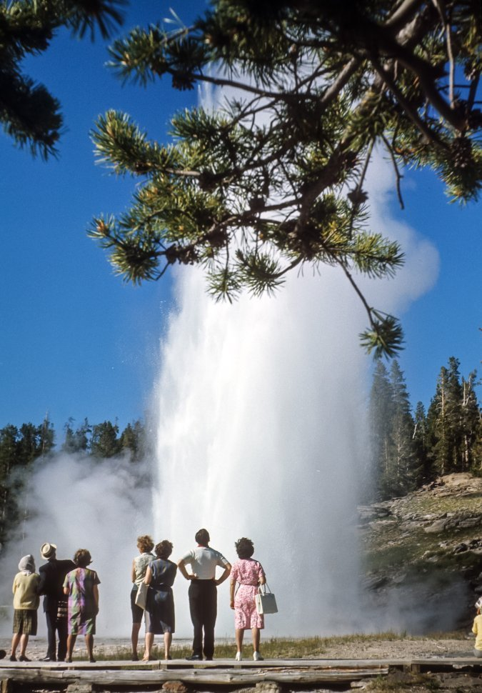 Free image of Tourists watching Old Faithful the geyser erupt, Yellowstone National Park Wyoming, USA