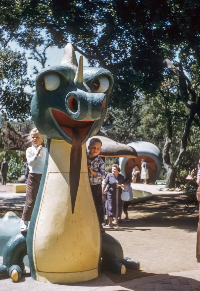 Free image of Children climbing a dragon in a park, USA