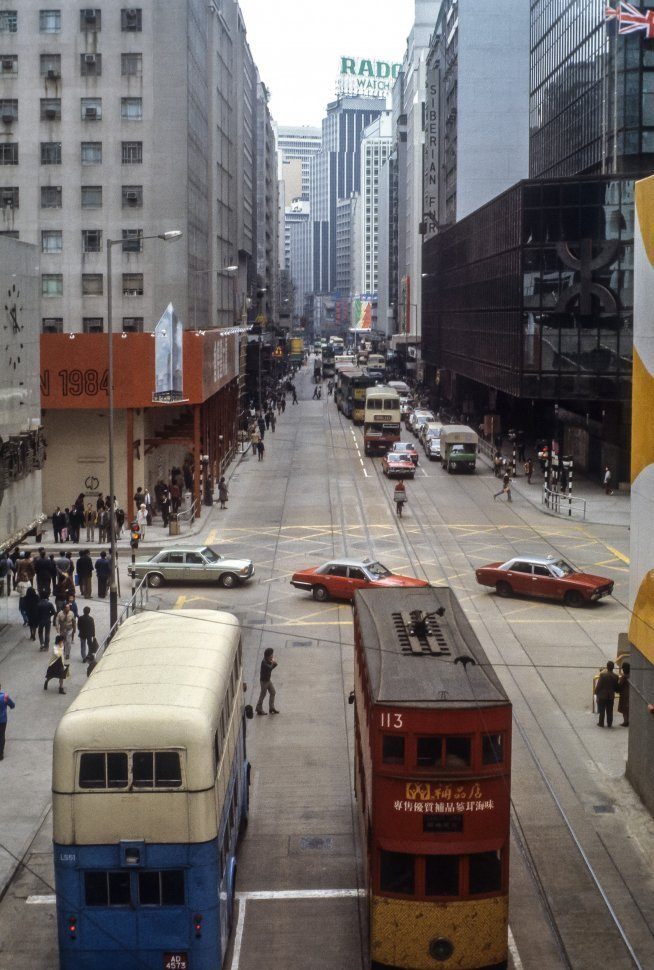 Free image of Double decker buses and crowds on city streets, China