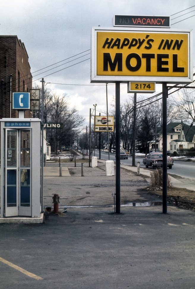 Free image of Sign for a roadside motel and phone booth, USA