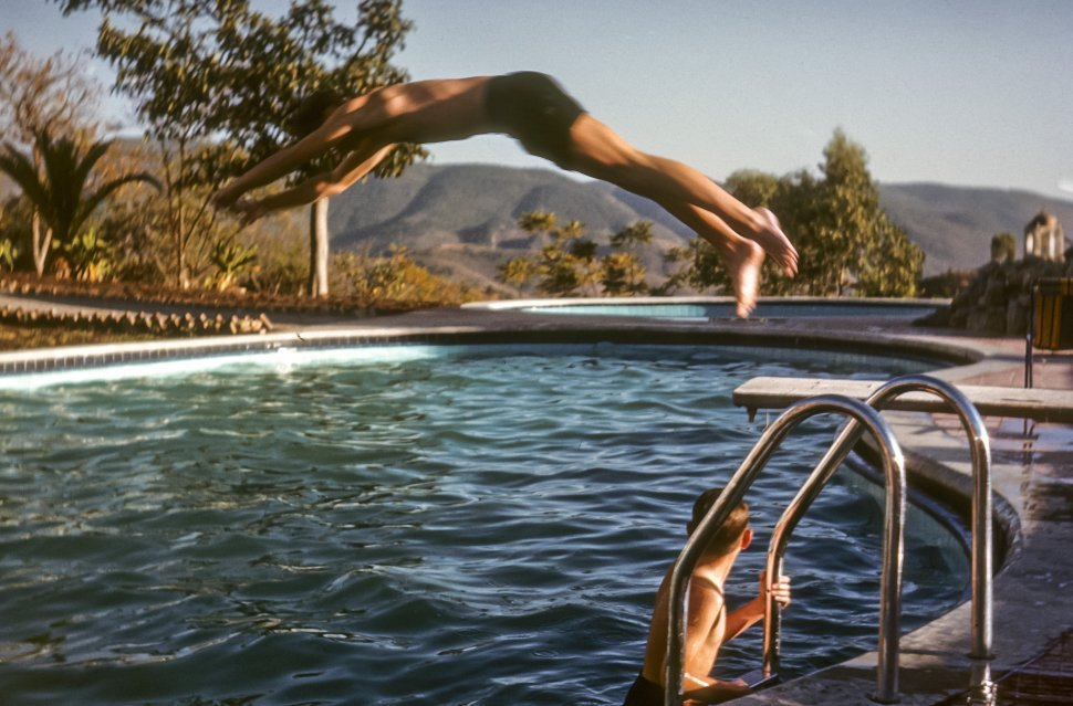 Free image of Kids diving and swimming in a pool, USA