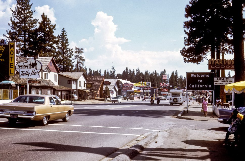 Free image of Motels, cars, and tourists line the road in South Lake Tahoe, Nevada, USA