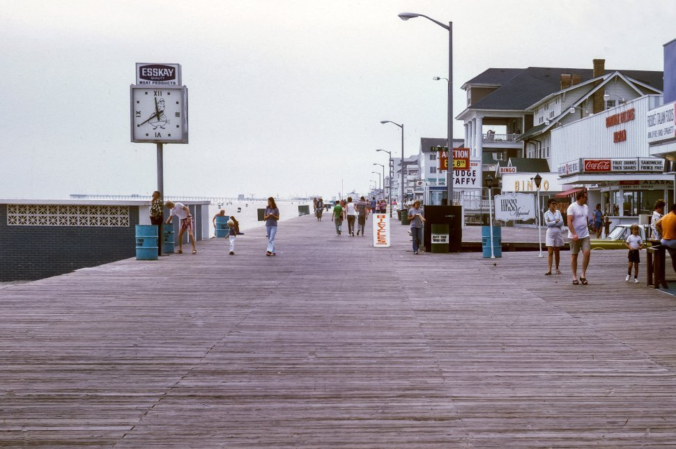 Free image of Tourist families walking down the boardwalk, Ocean City, Maryland, USA