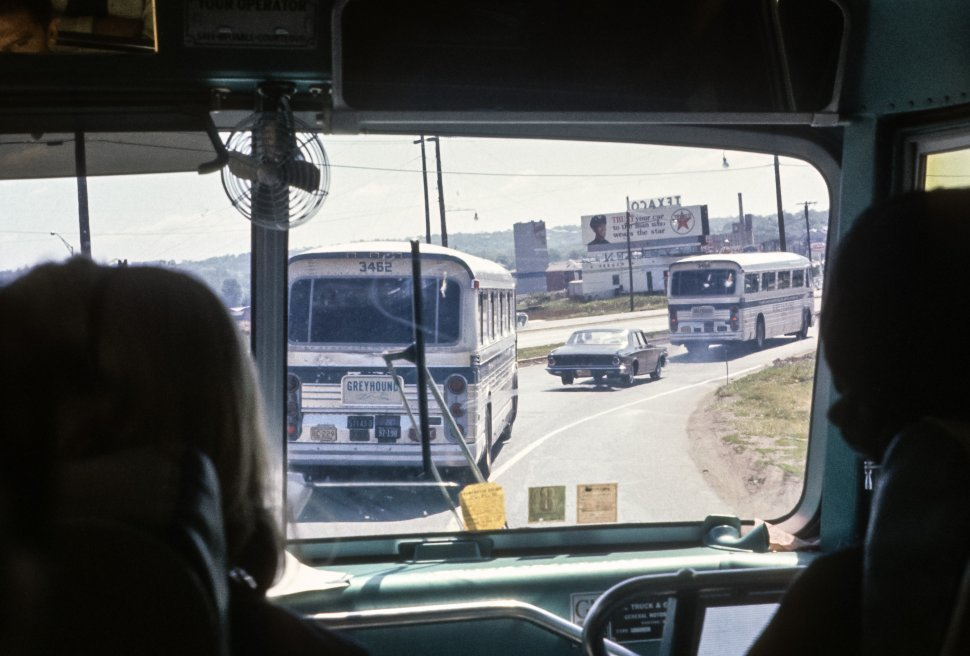 Free image of Tourists riding on buses in an area of industry, USA