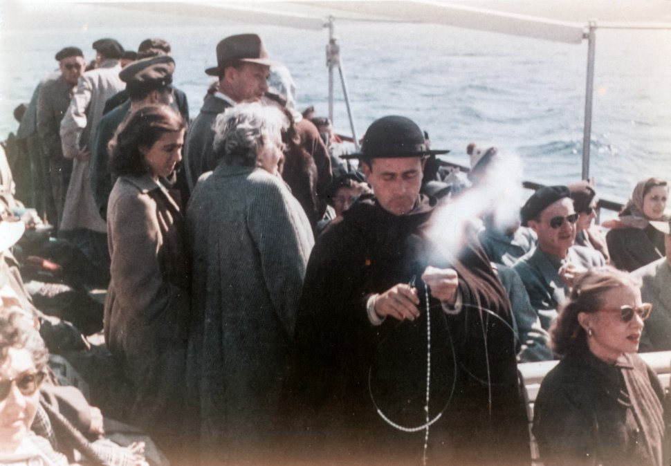 Free image of Catholic priest moving through a crowd of people with an incensce burner, Venice, Italy