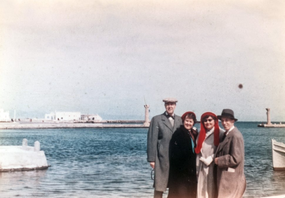 Free image of Two couples posing in front of the bay, Europe