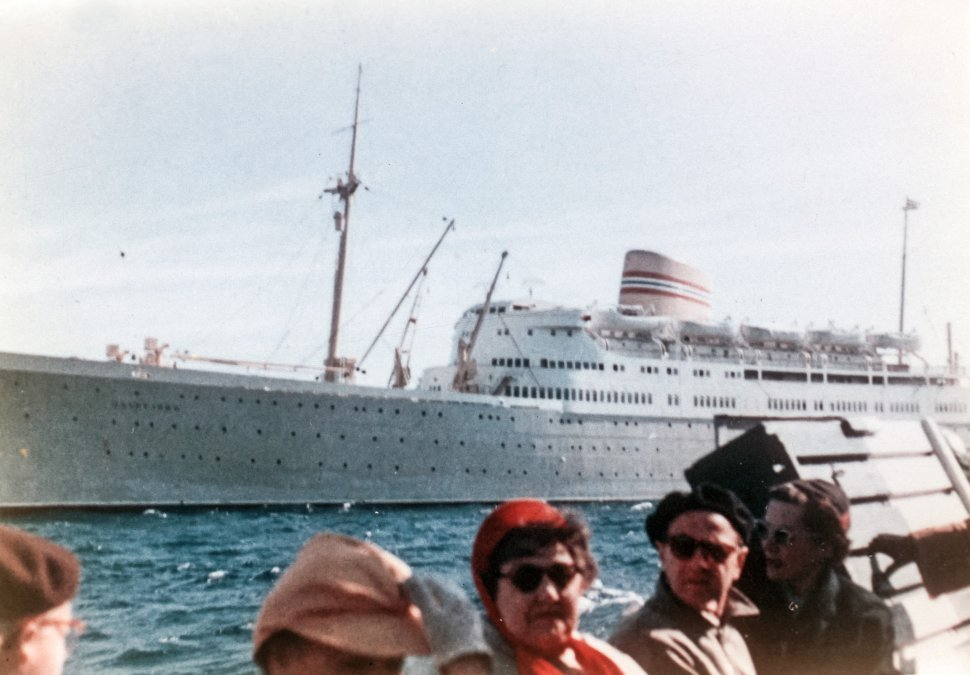 Free image of Tourists on a boat ride next to a large cruise ship, Venice, Italy