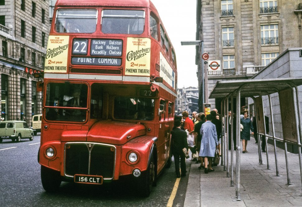 Free image of Tourists boarding a double decker bus, London, England