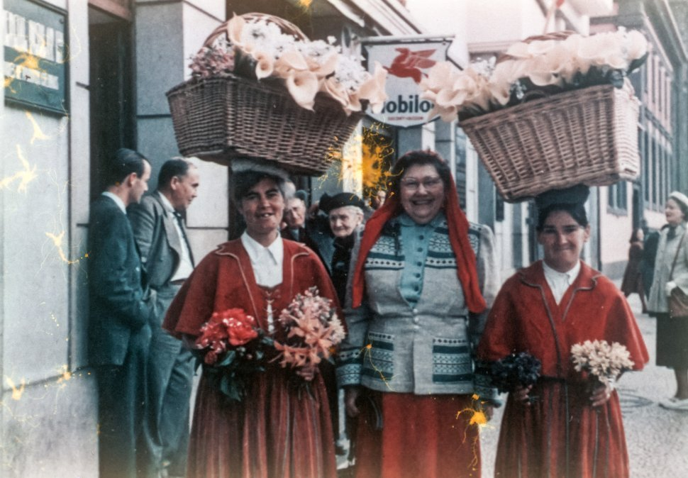 Free image of Women posing while carrying baskets of lilies on their heads, Europe