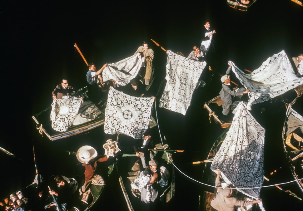 Free image of Aerial view of men and women hanging beautiful lace sails on their masts, Venice, Italy