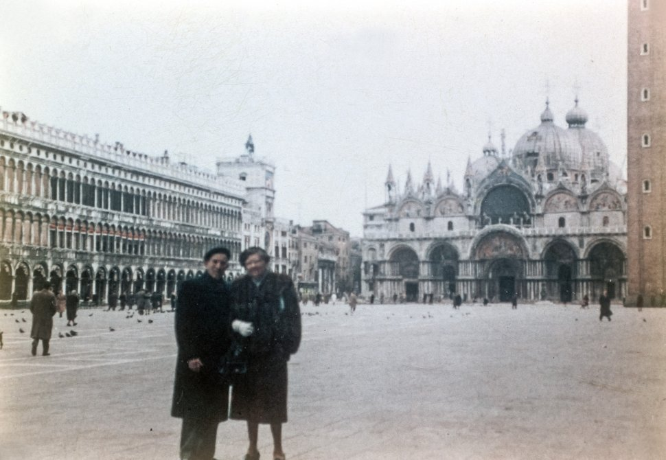 Free image of Portrait of a couple standing on the street in Piazza San Marco in front of St. Mark s basilica, Venice, Italy, Europe