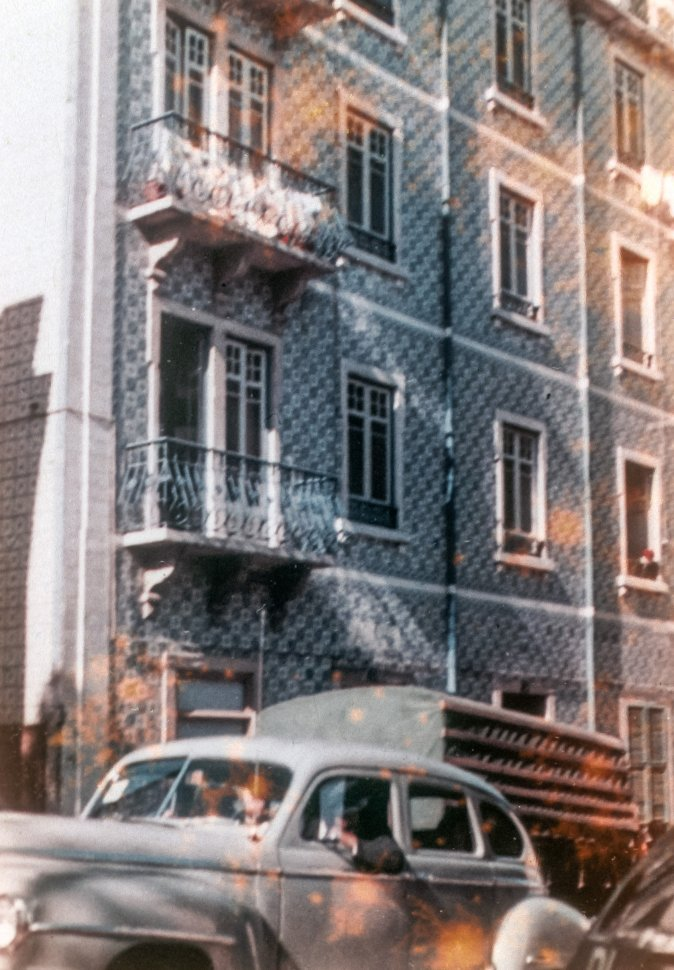 Free image of Facade of a tall apartment building with balconies lining the front, Europe