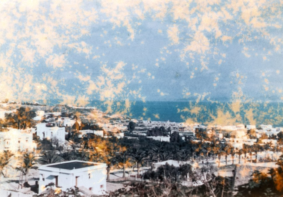 Free image of Weathered photograph of a white washed coastal town, Greece