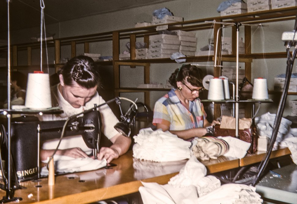 Free image of Two seamstresses working at their sewing machines, USA