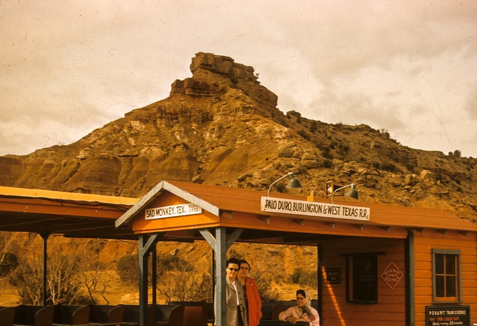 Free image of Three women posing for a picture at a Sad Monkey Railroad train stop, Palo Duro Canyon, Texas, USA