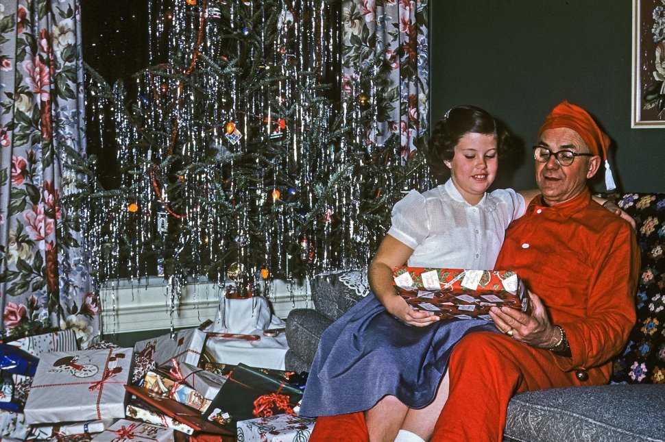 Free image of Girl giving her father a gift on Christmas morning, USA