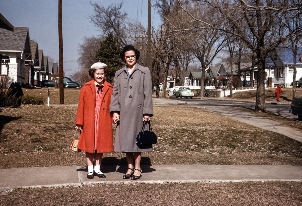 Free image of Woman and young girl posing on the sidewalk, USA
