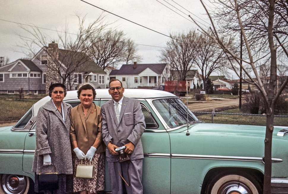Free image of Portrait of a family in front of a vintage car a car, USA