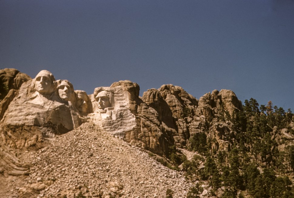 Free image of Carving of presidents George Washington, Thomas Jefferson, Theodore Roosevelt and Abraham Lincoln making up Mount Rushmore, South Dakota, USA