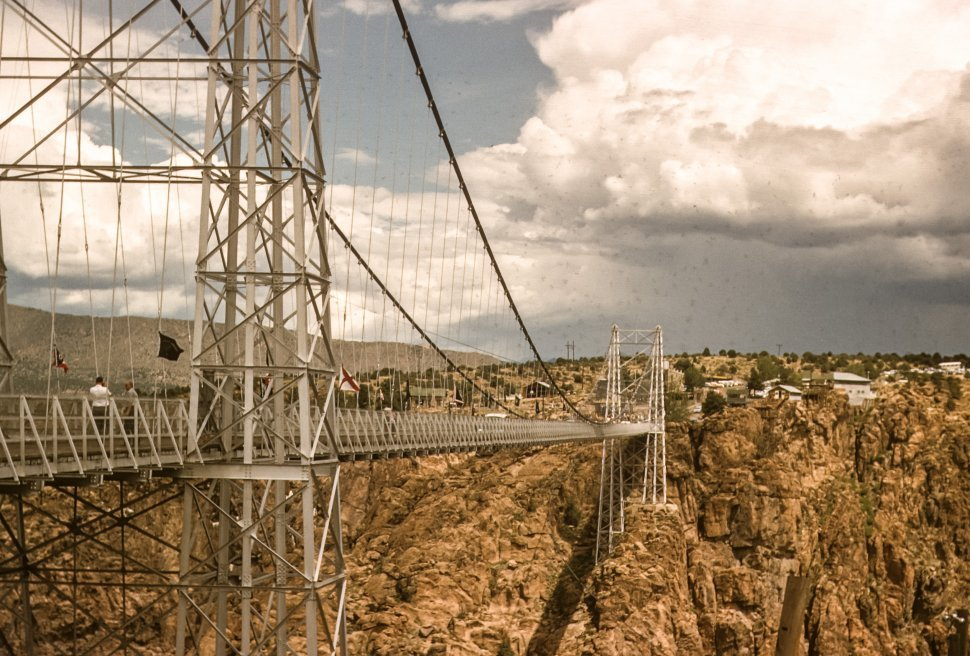 Free image of Man crossing a suspension bridge in the desert, USA
