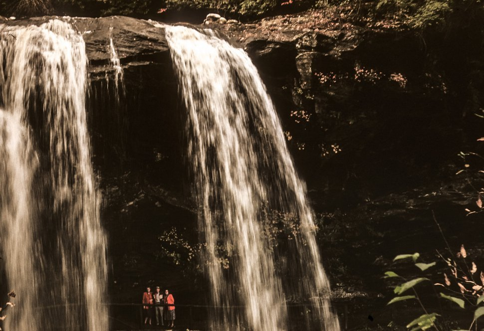 Free image of Three people posing under waterfall, USA