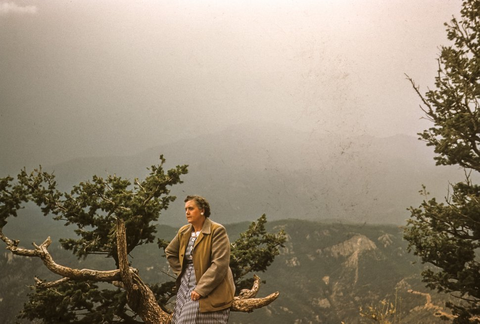 Free image of Woman posing in front of canyon and mist, USA
