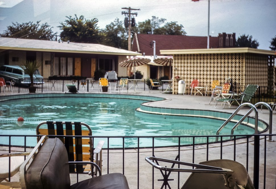 Free image of Motel pool area with furniture, USA
