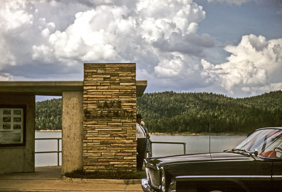 Free image of Man standing at a lakeside rest stop, Lake Ouachita, Arkansas, USA