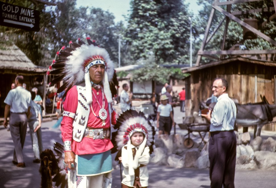 Free image of Native American Man and child standing in at Knott s Berry Farm park, California, USA