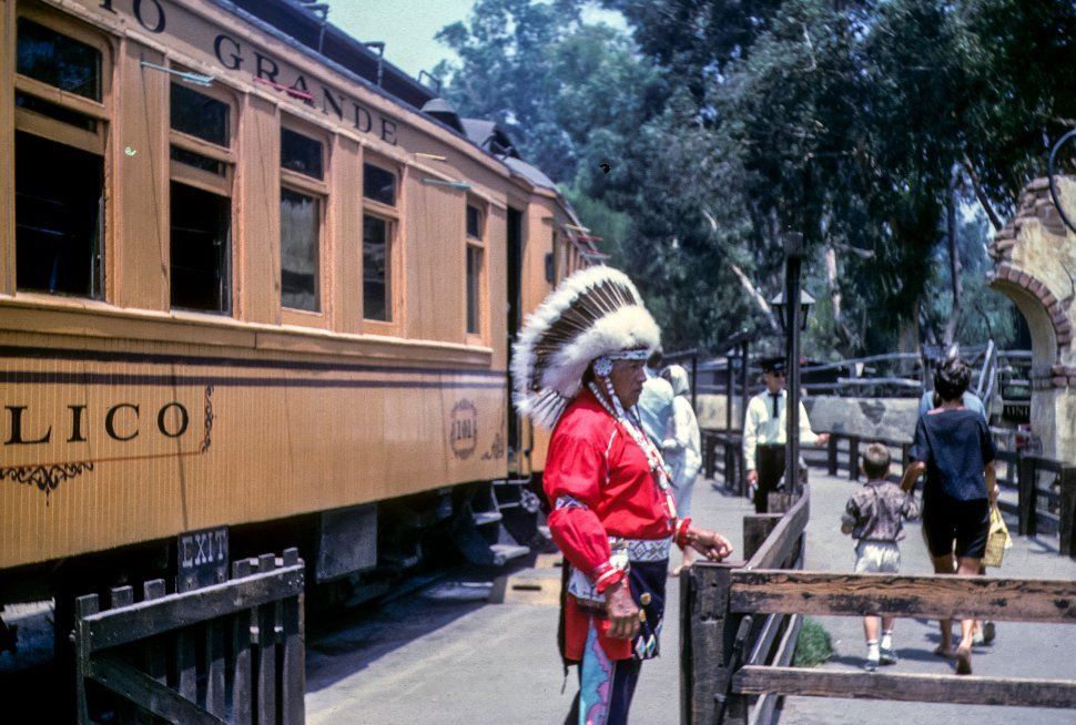 Free image of Man standing in a Native American garb at a Knott s Berry Farm, California, USA