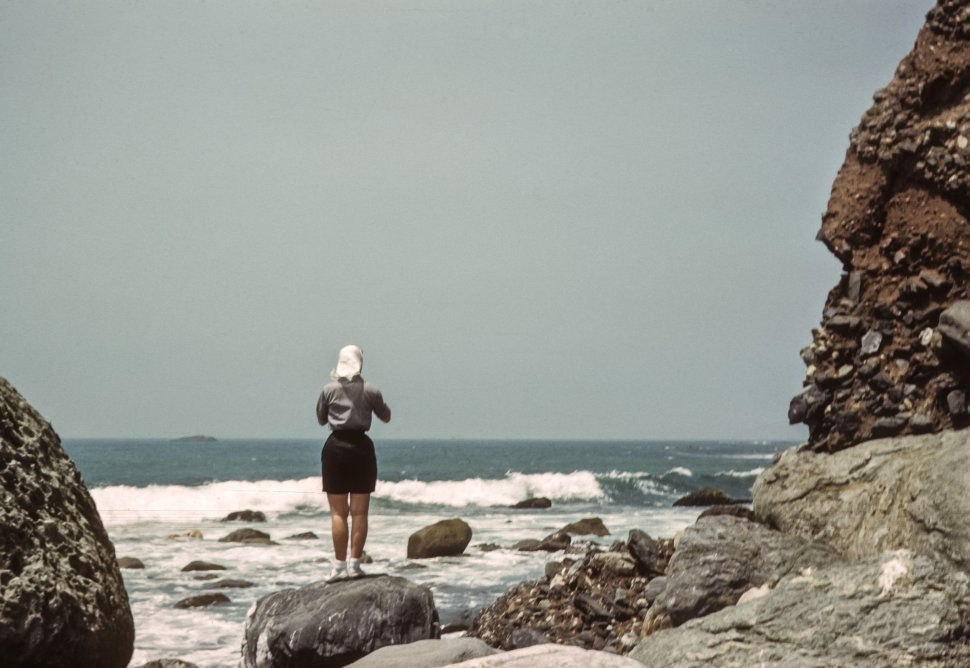 Free image of Woman taking photographs of the ocean, USA