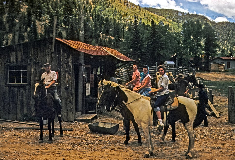 Free image of Group of tourists on horseback posing for a picture, USA