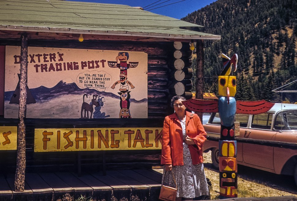 Free image of Tourist standing in front of a western trading post gift shop, Red River, New Mexico, USA