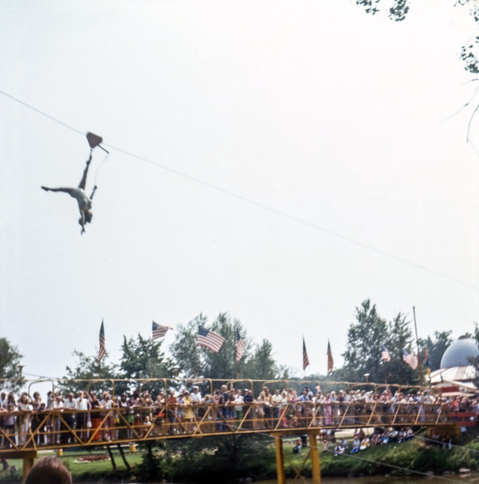 Free image of Trapese artist flying above a crowd, USA